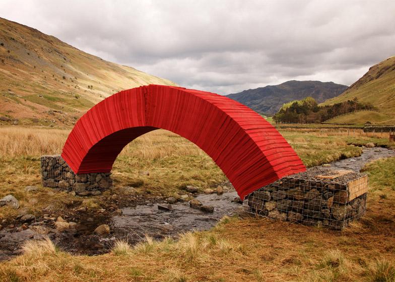 Steve Messam creates crimson bridge from 20,000 sheets of paper
