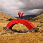 Steve Messam creates crimson bridge from 20,000 sheets of paper