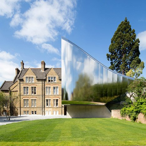 Zaha Hadid adds a shimmery steel tunnel to an Oxford University college