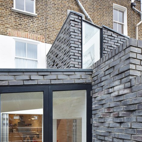 Fraher Architects includes textured brick cladding on north London house extension