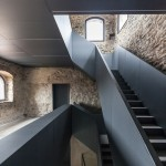 Gianluca Gelmini inserts an angular iron staircase inside a medieval Italian fortress