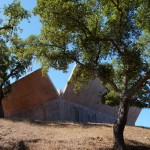Splayed concrete walls give Valerio Olgiati's Villa Além the appearance of an open box