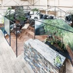 Takehiko Nez divides up a hair salon with mirrors, translucent screens and plants