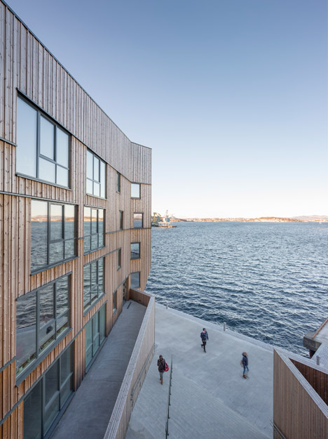 """Faceted waterfront housing in Norway conceived as """"a mountain range of wood"""""""