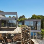 Rugged drystone wall frames Whitehall Road Residence by B.E. Architecture