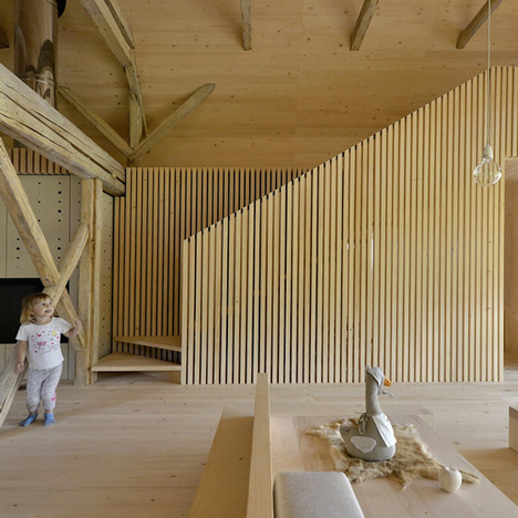Alpine Barn Apartment by OFIS Arhitekti is a holiday home in a converted cattle shed