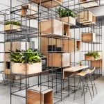 Steel rebar forms storage system at Toronto kitchen showroom by DesignAgency