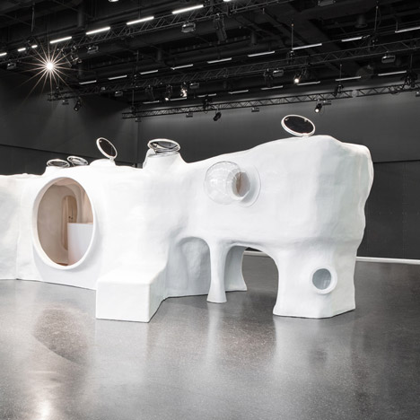 Atelier van Lieshout sculpts a hybrid cave dwelling and pool house