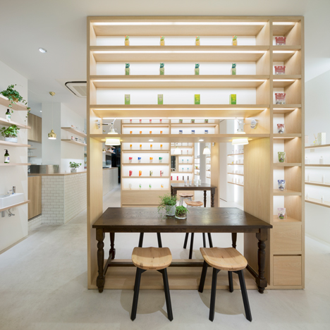 Nendo's Beauty Library presents organic cosmetics on bookshelves