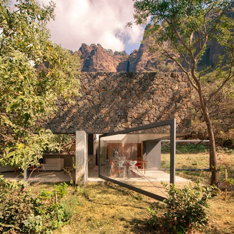 EDAA pairs volcanic stone with pivoting glazing at Casa Meztitla in Mexico