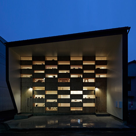 Glass and timber rectangles create chequered facade for Tokyo house by Takeshi Shikauchi