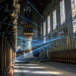 Blue cord criss-crosses the interior of an abandoned church in Philadelphia