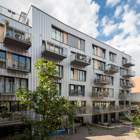 Brutopia is an aluminium-clad apartment complex built by a cooperative in Brussels