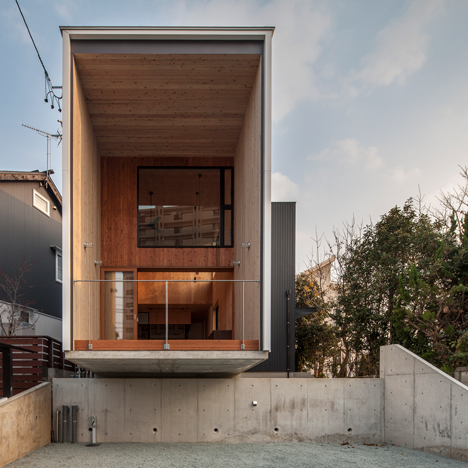 Fly Out House balances on a concrete wall to avoid overlooking a busy road