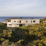 "Beach house by Ruhl Walker Architects designed to ""curve and shift"" with the landscape"