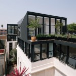Cadaval & Solà-Morales installs angular black penthouses during renovation of a 1920s building