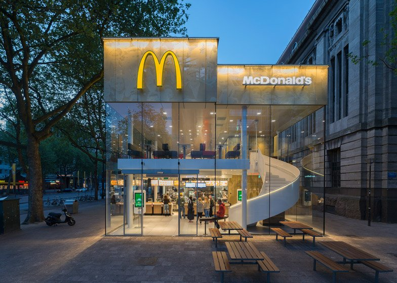 Restaurant Facade mcdonald's restaurant has a golden facade and spiral staircase