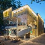 McDonald's restaurant by Mei Architects boasts a golden facade and a spiral staircase