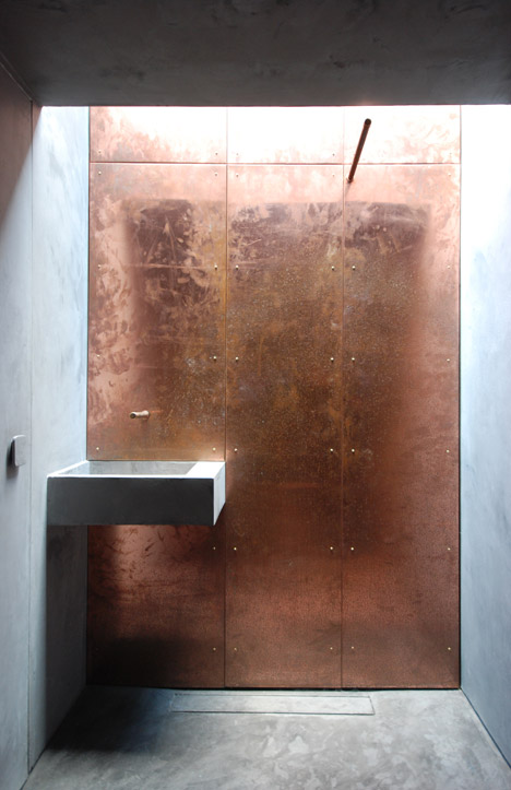 Copper studio by stonewood design is also a wildlife hide for Bathroom wet wall designs