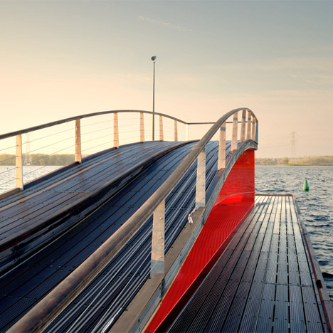 René van Zuuk creates a wavy pier with an integrated lightbox over an Almere lake