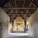 Private art gallery by Stonewood Design cantilevers into a 17th-century Cotswolds barn