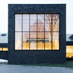 Omgeving's black brick library in Zoersel is subdivided into smaller blocks