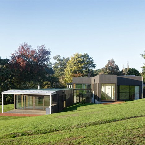 Honeyman + Smith Architects adds a hillside-hugging extension to an Australian farmhouse