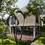 MM++ Architects replaces the old walls of a Vietnam house with red bricks and pivoting glass