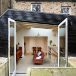 Blackened timber extension by Fraher Architects provides a new kitchen for a keen cook