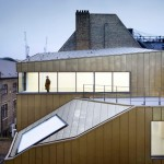 Shoreditch office by Piercy & Company has a restored facade and a golden behind