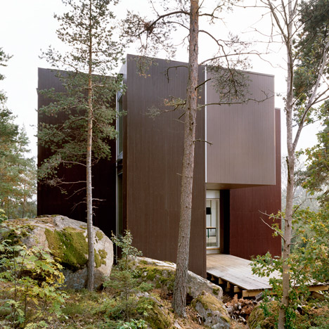 Villa Altona by The Common Office fits around the trees of a Swedish woodland hill