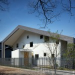 House in Wakayama by Spray shelters four triangular terraces beneath its wonky roof