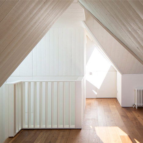 "Hampstead loft conversion by Alexander Martin features ""a new twist on the hidden library door"""