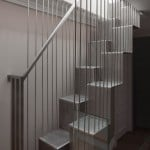 DBLO Associates adds perforated steel staircase to refurbished London home