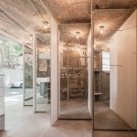 Linehouse installs diagonal partitions and mirrored panels in a Shanghai boutique