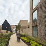 Chequered brickwork brings unity to a Cambridge housing community by Proctor and Matthews