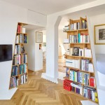 H2o Architectes adds sloping shelving units to a book collector's Parisian loft apartment