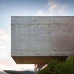 Cantilevered concrete box houses poolside bar at weekend retreat in Belo Horizonte