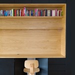 Wooden niches contain work surfaces and storage inside Black Line Apartment by Arhitektura d.o.o.