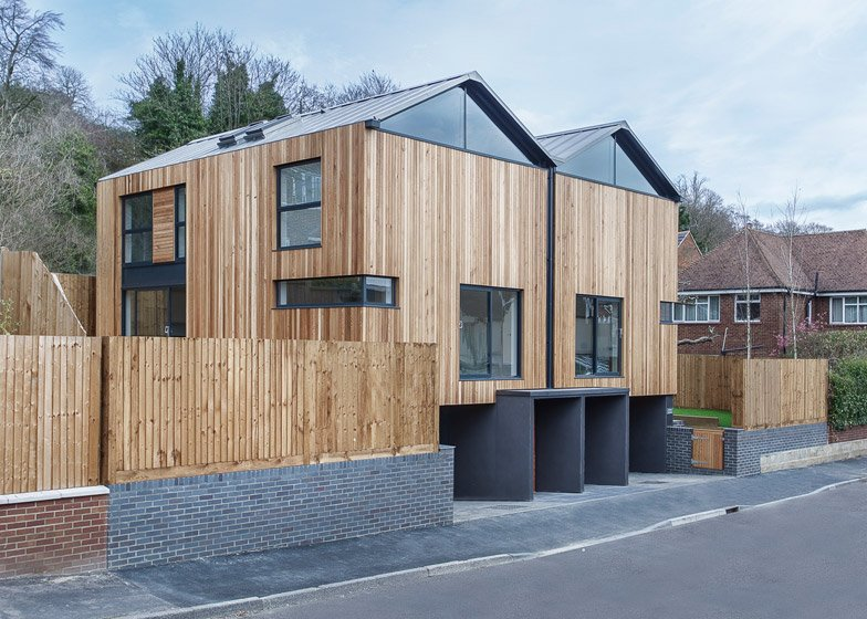 Twin wooden houses by adam knibb architects are raised up for Contemporary timber homes