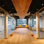 Wooden catwalk installed in conference room to encourage livelier presentations