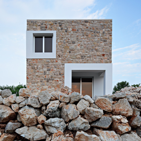 "Holiday ""village"" for an ex-footballer comprises seven cuboids with stone walls"