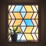 "Marjan van Aubel's ""stained glass window"" harvests solar energy to charge mobile phones"