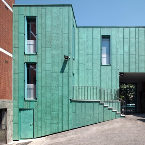 Maurizio Bradaschia adds green-painted extension to an Italian police station