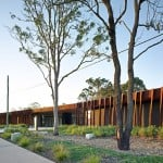 Rusty metal panels clad Kirk's Fitzgibbon Community Centre in Brisbane