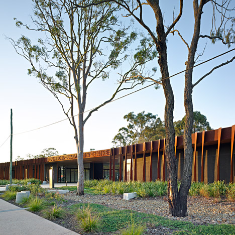 Pre-rusted metal panels clad Kirk's Fitzgibbon Community Centre in Brisbane