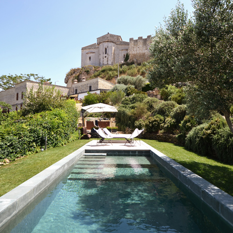 Slate-clad Fontanile Pool frames views of the Italian countryside from the garden of an old villa