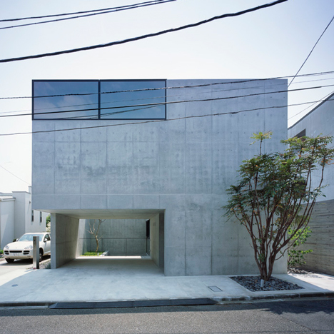 Apollo Architects creates spaces for artwork and cars in raw concrete Grigio house