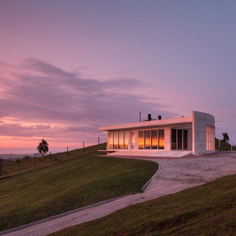 HLM House by Rafael Lorentz is a hilltop Brazil residence built from white concrete