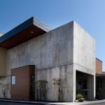 Yoshiyasu Mizuno creates raw concrete office block for fish-processing plant